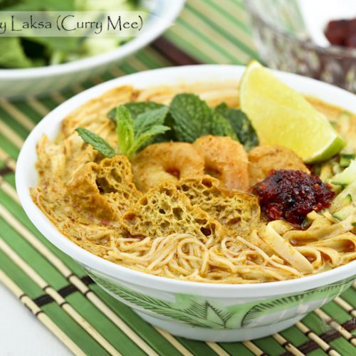 Curry Laksa (Curry Mee) is a delicious spicy curried noodle soup with a variety of toppings. This is my family's version found mainly in the Klang Valley and its surrounding areas.   MalaysianChineseKitchen.com