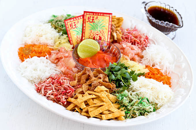Usher in the Chinese New Year with this colorful Yee Sang (Prosperity Toss Salad). It is a fun and tasty salad symbolizing abundance, prosperity, and vigor. | MalaysianChineseKitchen.com #yeesang #yusheng #chinesenewyear #lunarnewyear