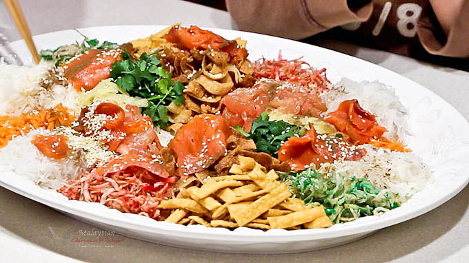 Usher in the Chinese New Year with this colorful Yee Sang (Prosperity Toss Salad). It is a fun and tasty salad symbolizing abundance, prosperity, and vigor. | MalaysianChineseKitchen.com