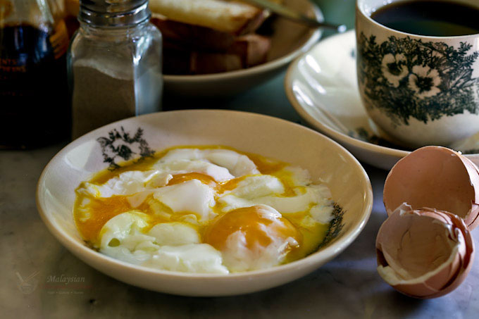Half Boiled Eggs and toast are a favorite Malaysian breakfast. Learn how to cook them to a soft, creamy, and delicious perfection in a hot water bath. | MalaysianChineseKitchen.com
