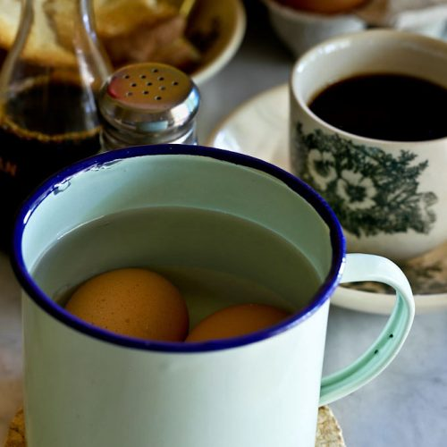 Half Boiled Eggs cooking in enamel mug.