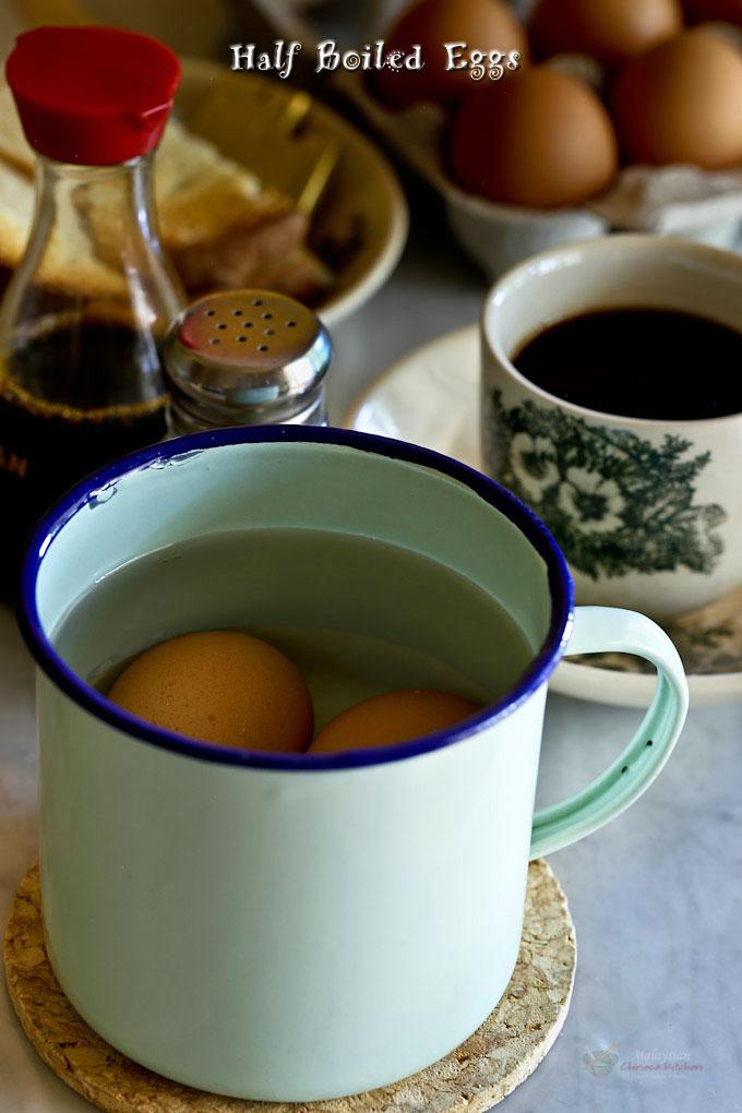 Half Boiled Eggs cooking in enamel mug.