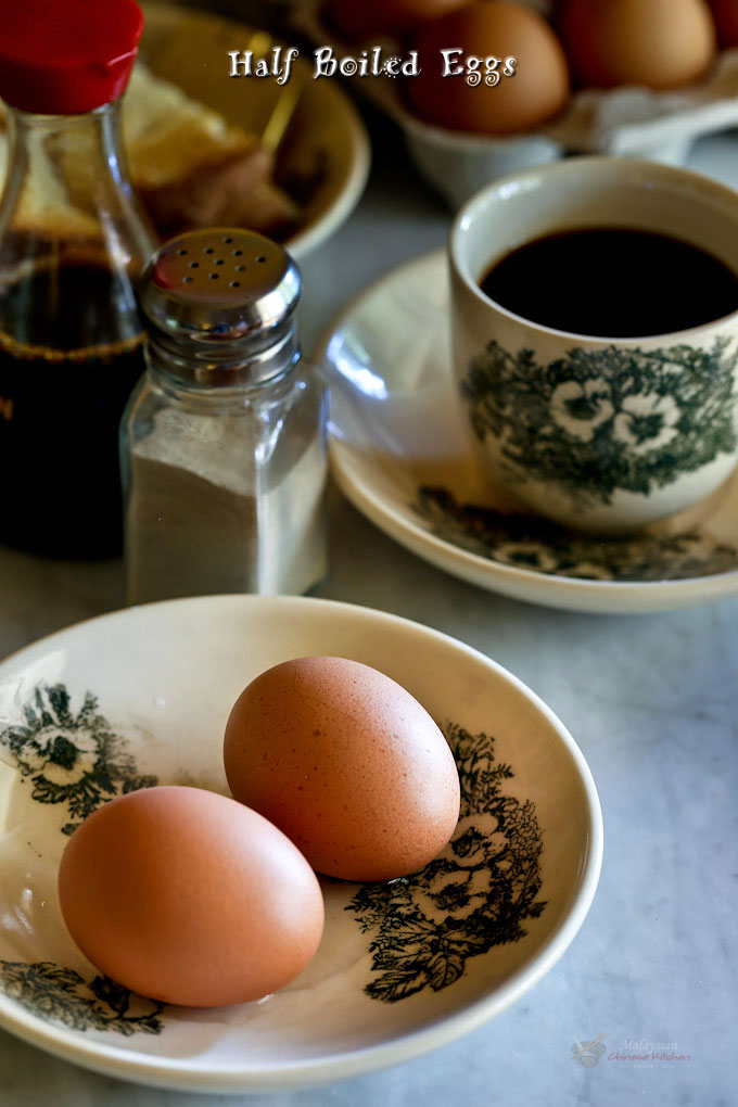 Freshly cooked Half Boiled Eggs with toast and coffee.