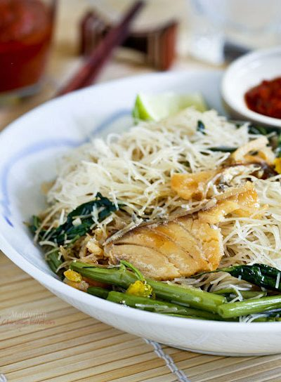 Kiam Hu Beehoon is fried rice noodles with salted fish, eggs, and kangkung. It is very tasty served with sambal belacan and lime wedges. A must try! | MalaysianChineseKitchen.com