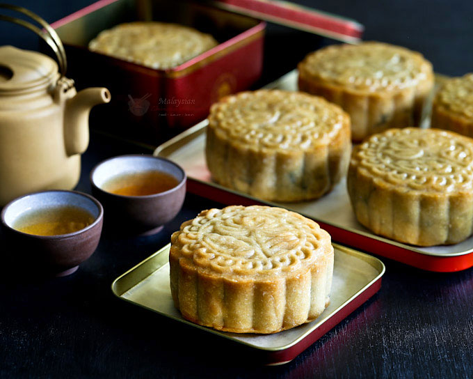 Vegetarian Purple Yam Mooncakes filled with homemade purple yam and sweet potato paste center to simulate salted egg yolk. Melon seeds provide texture. | MalaysianChineseKitchen.com