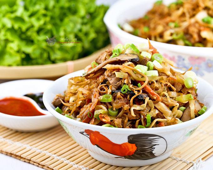 Jiu Hu Char (Stir Fry Jicama with Cuttlefish) is a popular Nyonya side dish or lettuce wrap filling prepared for all major festivals.   MalaysianChineseKitchen.com