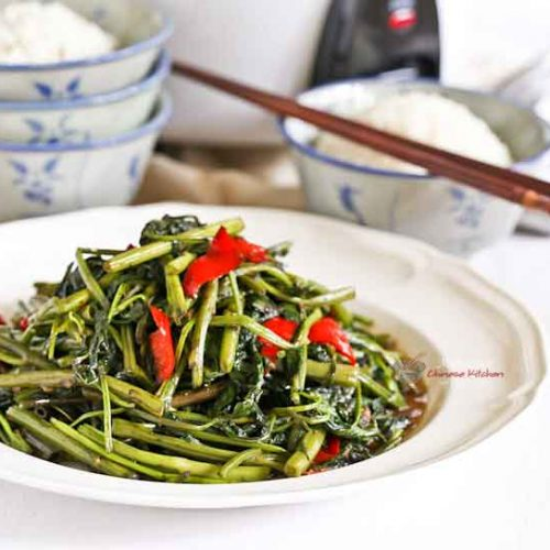 This Quick Style Kangkung Belacan is a twist on a popular Malaysian stir fry made simpler and quicker. Just as delicious with a bowl of rice.   MalaysianChineseKitchen.com