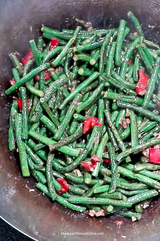 Stir Fry Long Beans in the wok.