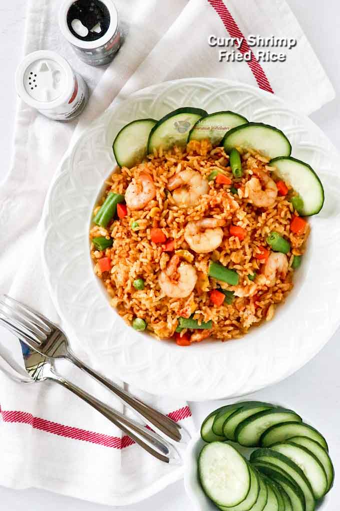 Curry Shrimp Fried Rice with egg and mixed vegetables.