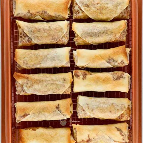 Golden Baked Spring Rolls in baking tray fresh out of the oven.