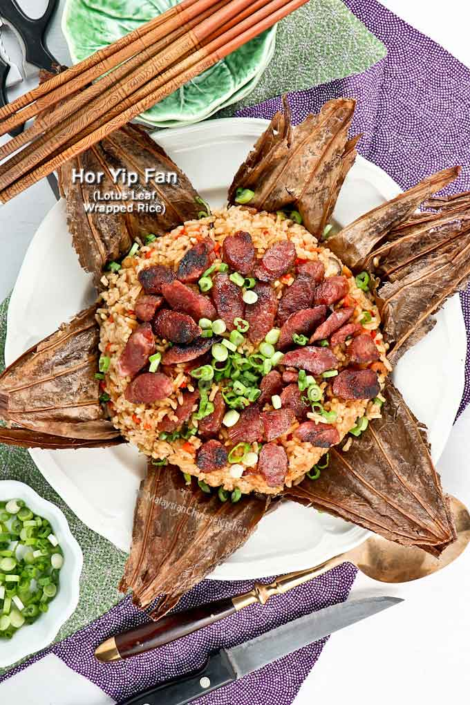 Hor Yip Fan is a combination of rice, Chinese sausage, mushrooms, and other goodies wrapped in lotus leaf. This fragrant and delicious rice is usually served at the end of a wedding feast or festival dinner. | MalaysianChineseKitchen.com