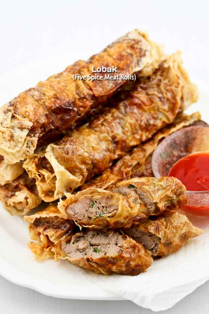 These super yummy Lobak (Five-Spice Meat Rolls) are made with beancurd sheets, pork tenderloin, and spices. They are deliciously crispy on the outside and tender on the inside. Also very easy to prepare. | MalaysianChineseKitchen.com