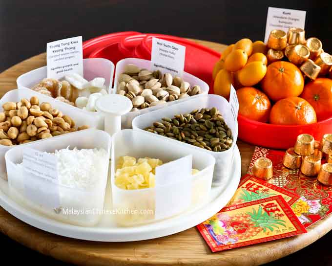 A guide to making your own Chinese New Year Candy Box (Tray of Togetherness) and the significance of each treat placed in there. | MalaysianChineseKitchen.com