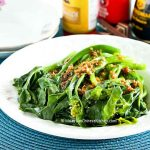 This tender crisp blanched baby Gai Lan (Chinese Broccoli) with Oyster Sauce is a dish served regularly at the dinner table. Very quick and easy to prepare. | MalaysianChineseKitchen.com
