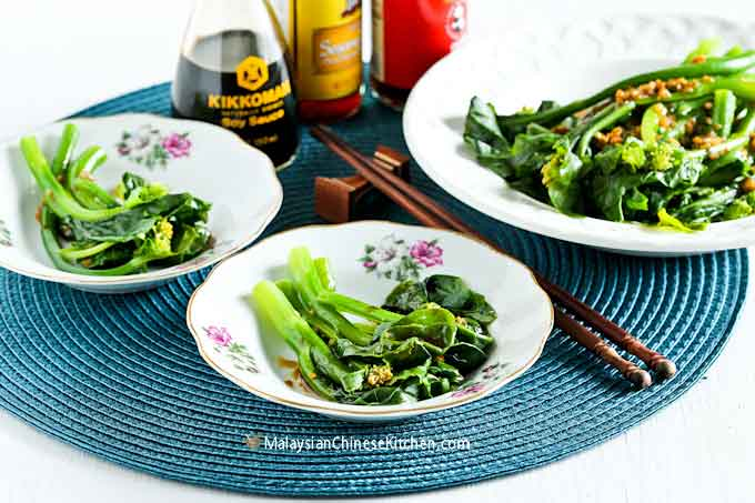 Tender crisp blanched baby Gai Lan (Chinese Broccoli) with Oyster Sauce served in small dishes