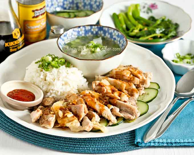Delicious Rice Cooker Hainanese Chicken Rice served with a bowl of soup.