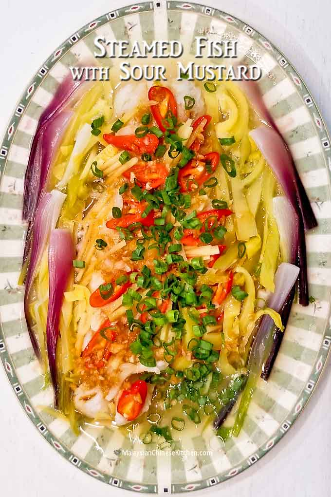 Light, tangy steamed fish with colorful garnishing.