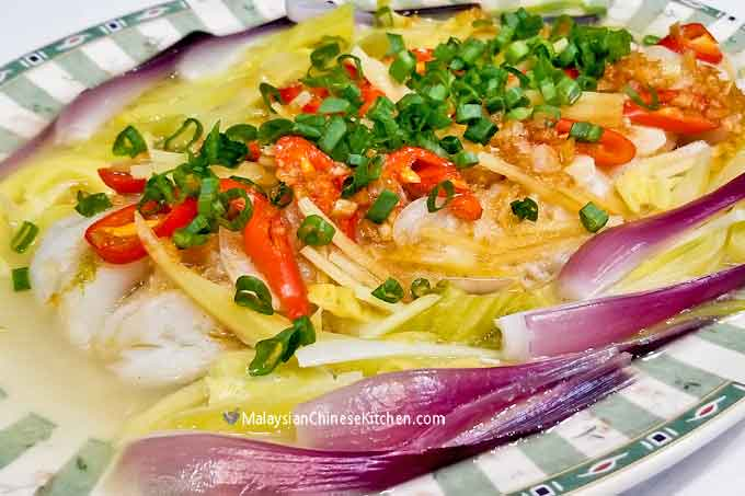 Delicious steamed fish with colorful garnishing.