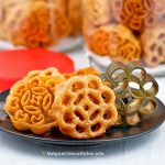 These fragrant and delicious Kuih Loyang (Rosettes/Honeycomb Cookies) are a real treat. They are ultra thin, super crispy, and easy to prepare.   MalaysianChineseKitchen.com #kuihloyang #rosettes #honeycombcookies #beehivecookies #kuihrose