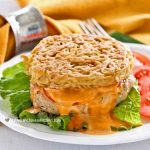 This Ramen Chicken Sausage Burger makes a super tasty meal for one using easily available ingredients. Also great for the lunchbox. | MalaysianChineseKitchen.com #ramenburger #chickensausageburger #ramenpatty