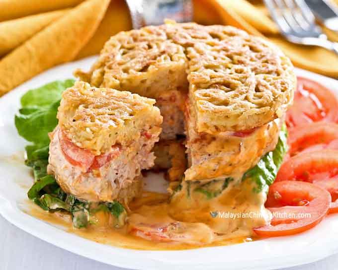 Ramen burger with chicken sausage patty.