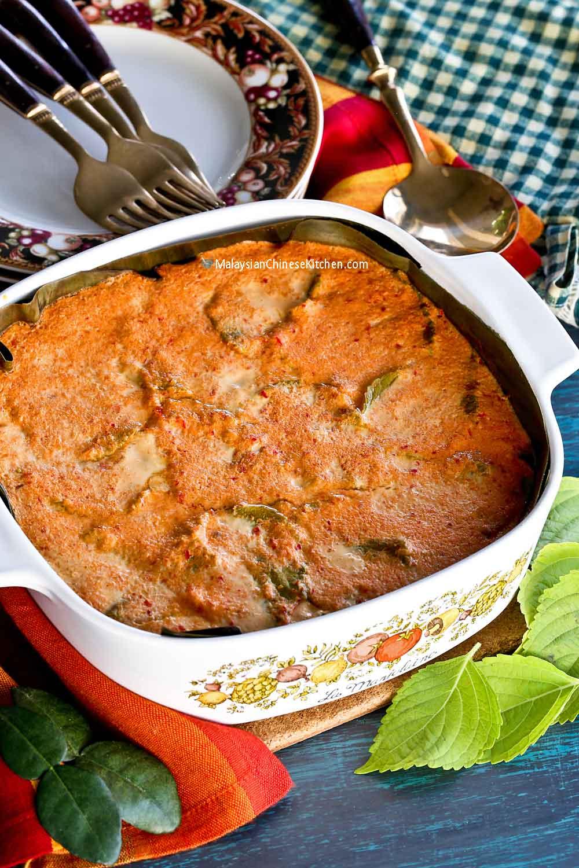 Steamed Otak-Otak in a banana leaf lined casserole dish.