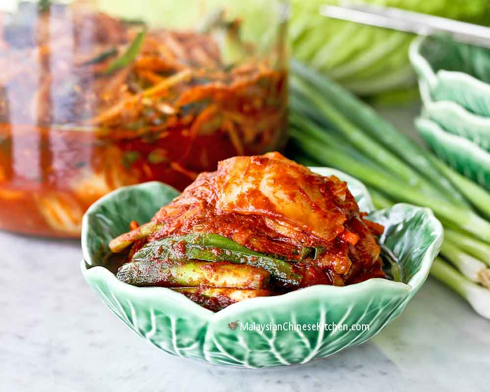 A delicious and spicy bowl of Napa Cabbage and Scallion Kimchi.