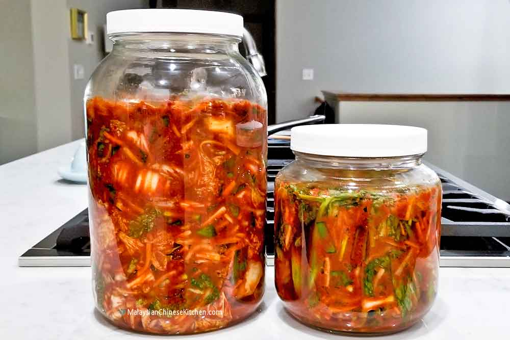 A second batch of cabbage kimchi and a small batch of mustard green kimchi.