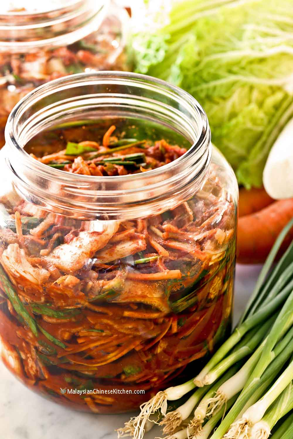 Freshly mixed cabbage kimchi stored in a bug large jar.