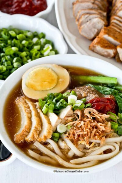 Lor Mee (Braised Noodles) with a thick gravy topped with slices of pork, tofu, fish cake, and egg.
