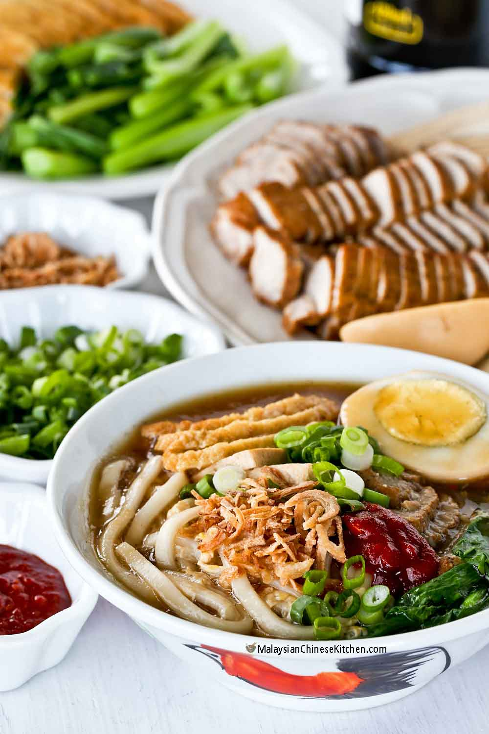 Lor Mee (Braised Noodles) served with a variety of toppings.