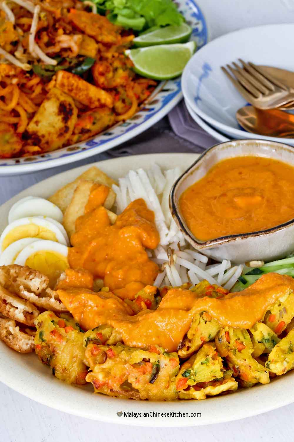Delicious Pasembur (Malaysian Indian Rojak) with crispy fritters and squid fritters.