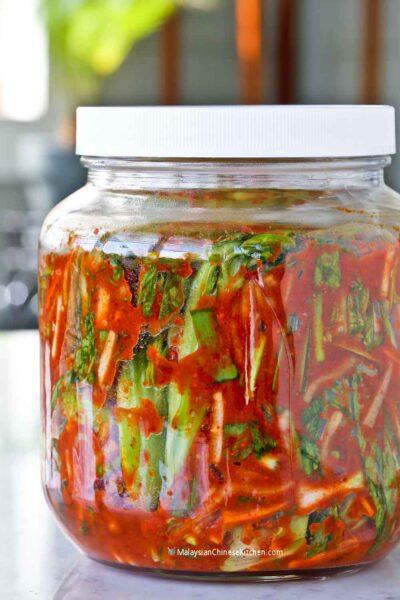 Freshly made Mustard Green Kimchi (Gat Kimchi) in a jar.