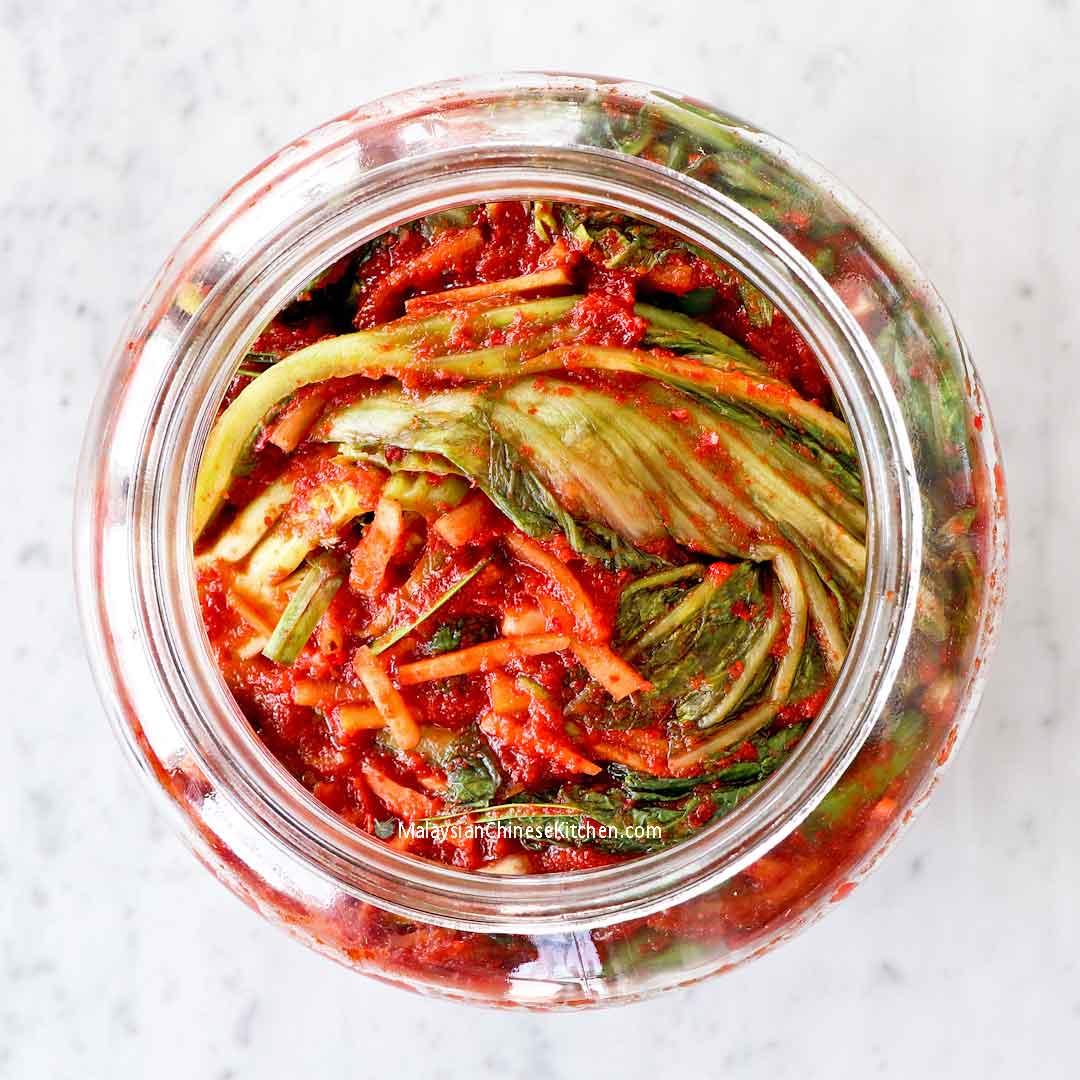 Mustard Greens Kimchi (Gat Kimchi) packed in a glass jar.