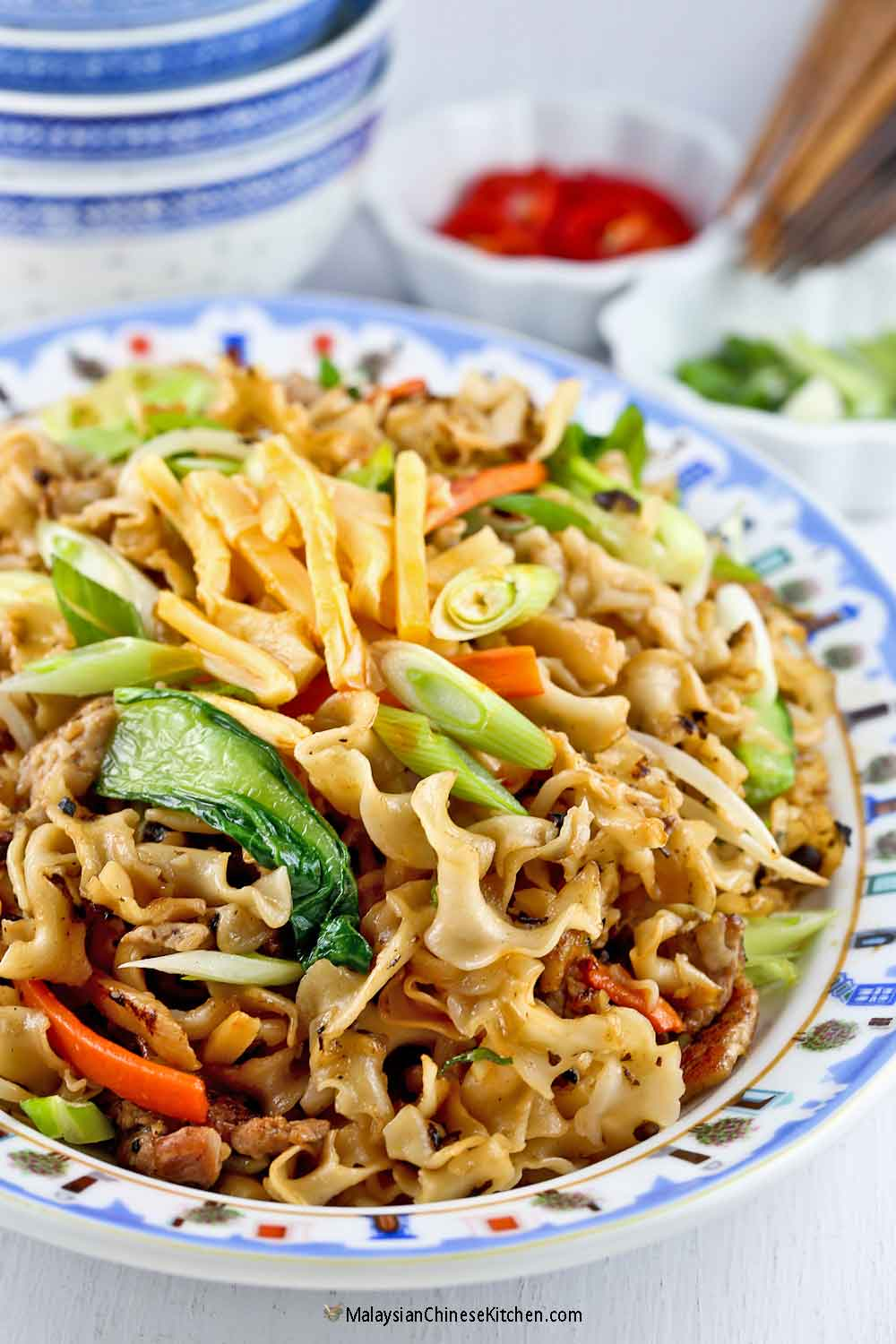 Knife Shaved Noodles Stir Fry with fermented black beans, chili bamboo shoots, and sliced pork.