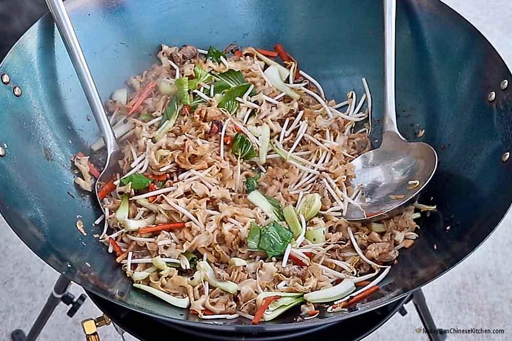 Knife Shaved Noodles Stir Fry in a 22 inch wok on the Big Kahuna Wok Burner.