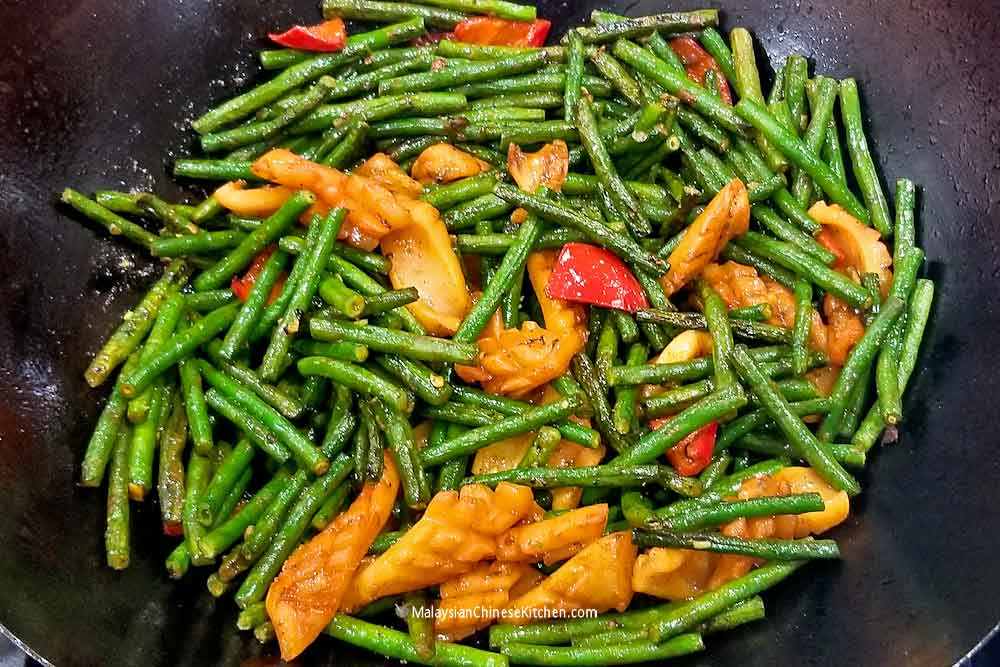 Squid and Long Beans Stir Fry in a wok.